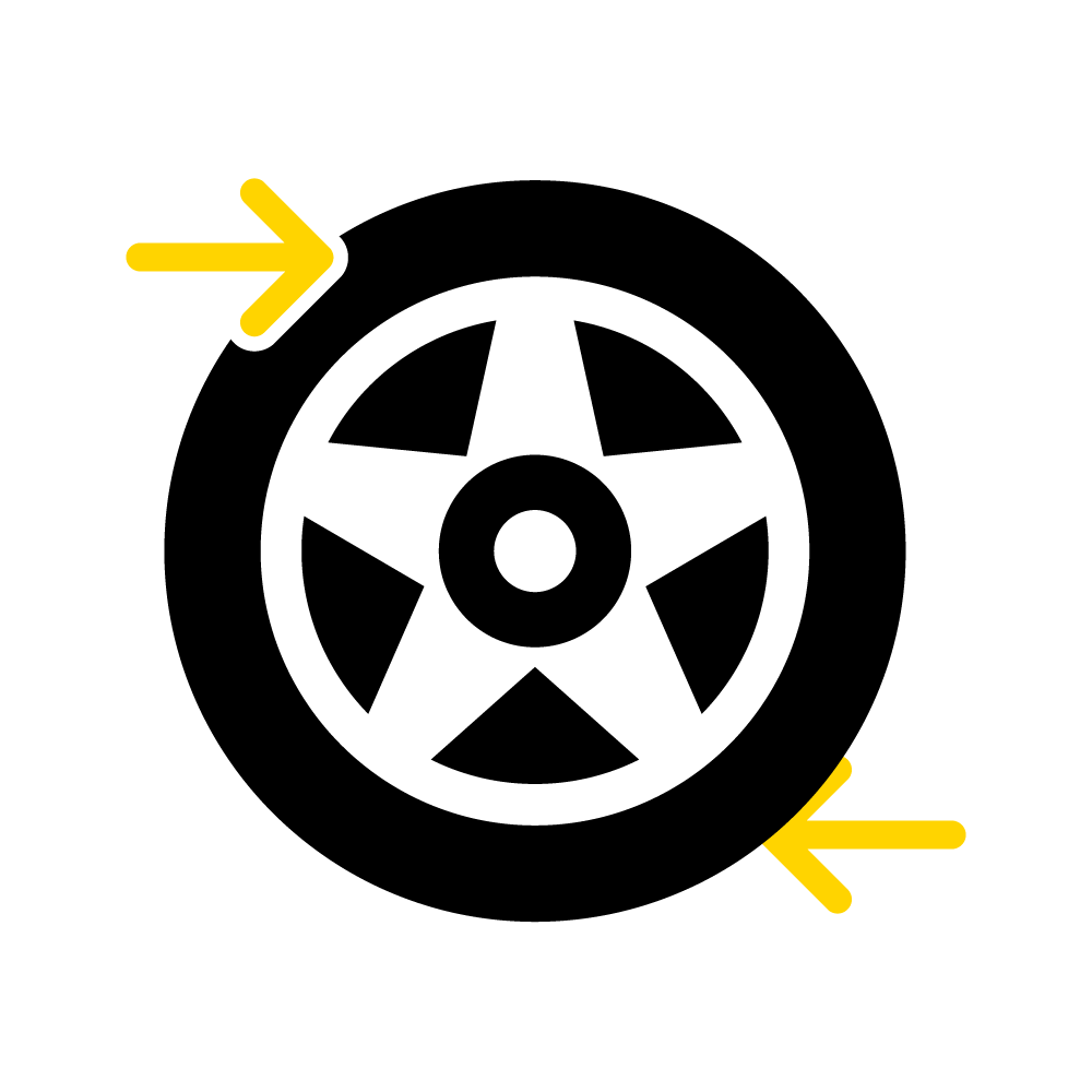 Two arrows indicate the rolling direction of a tyre.