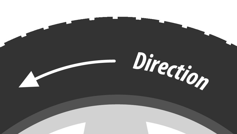 Una freccia indica il senso di marcia su uno pneumatico.