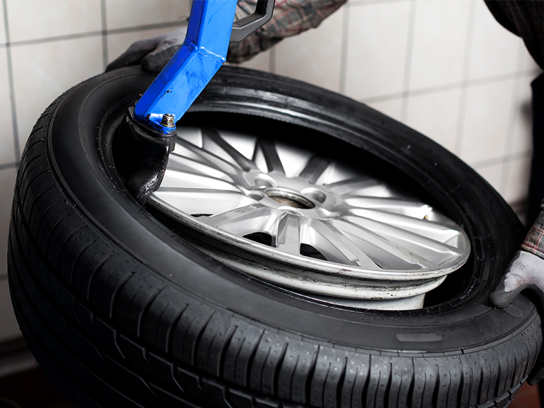 A tyre is fitted in a workshop.