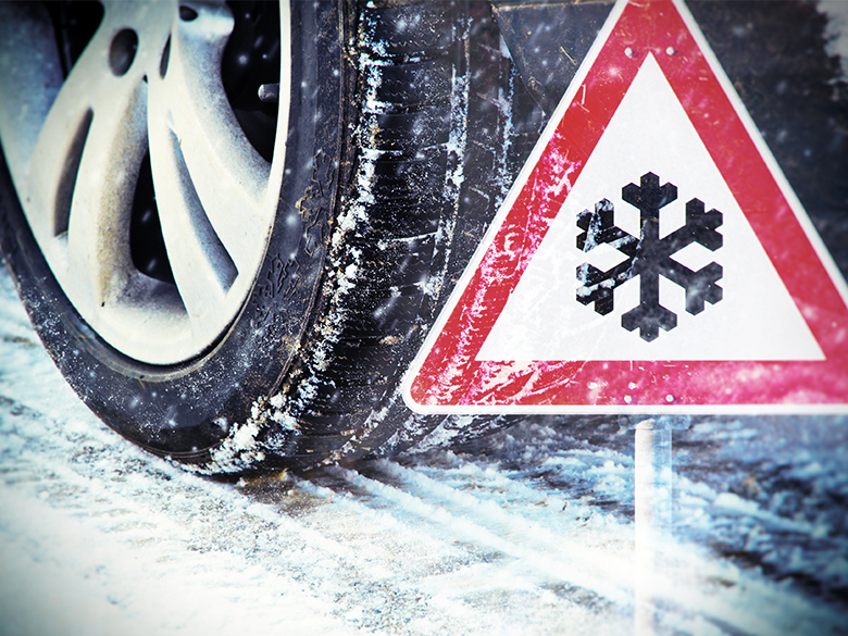 Mandatory winter tyres: A winter tyre on a snow-covered road.